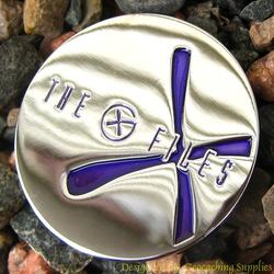 The G-Files - Chrome Geocoin with Purple X