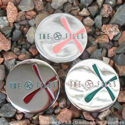 The G-Files - Chrome Geocoins with Chrstmas Colour Scheme